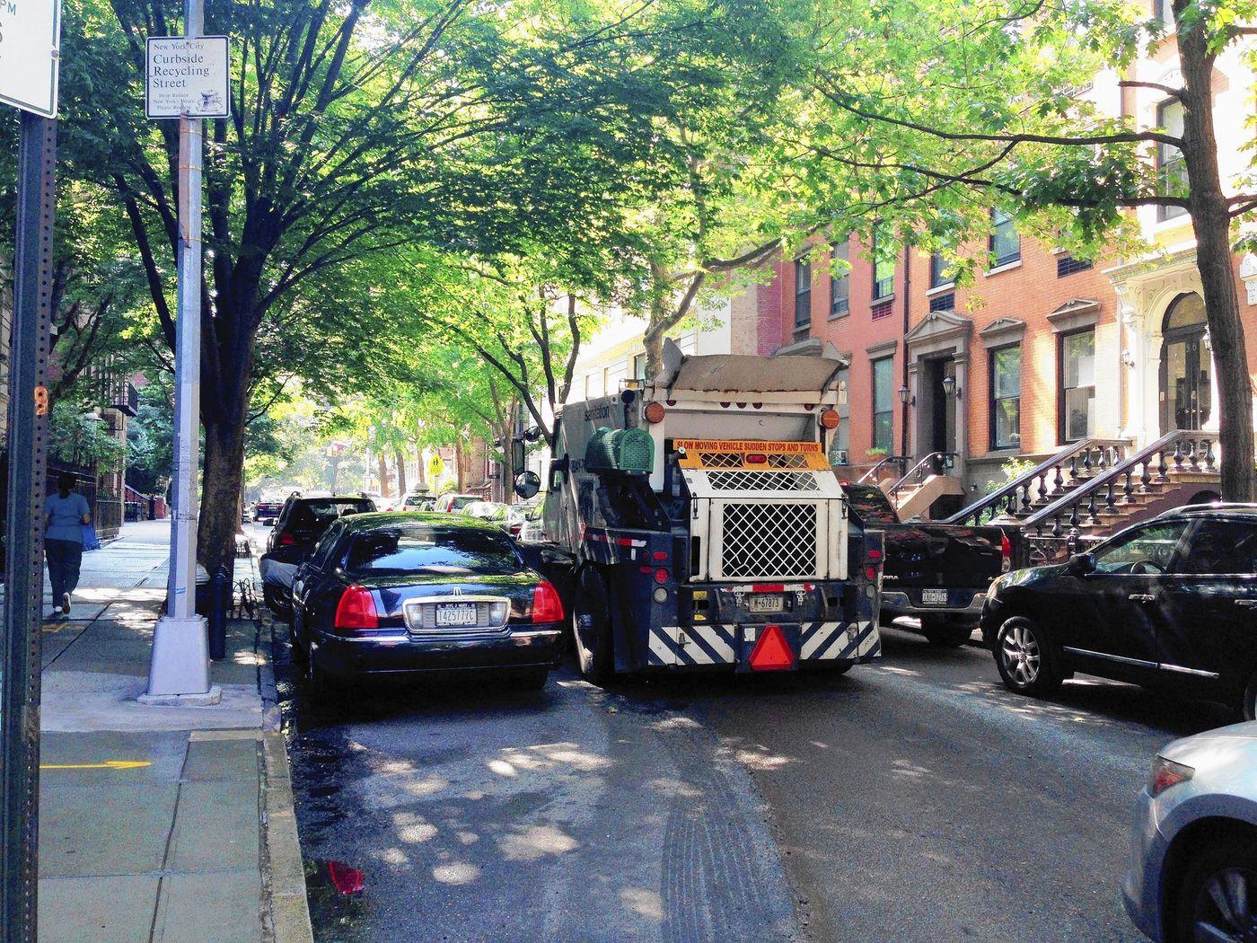 alternate side parking street sweeper sweeping